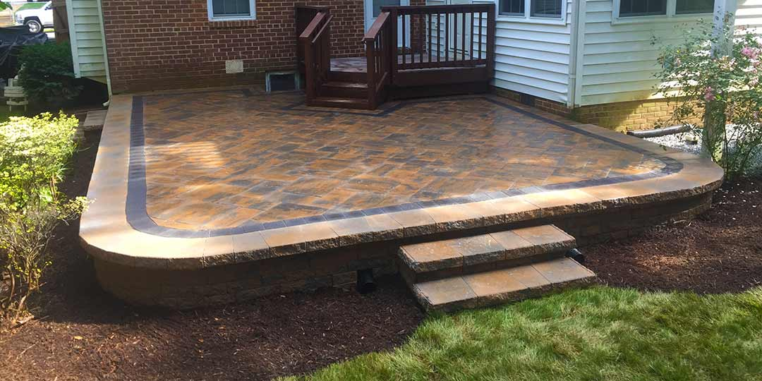 A home in Arlington, Virginia with a custom patio and steps installation.